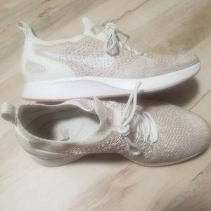 Cream Nike shoes